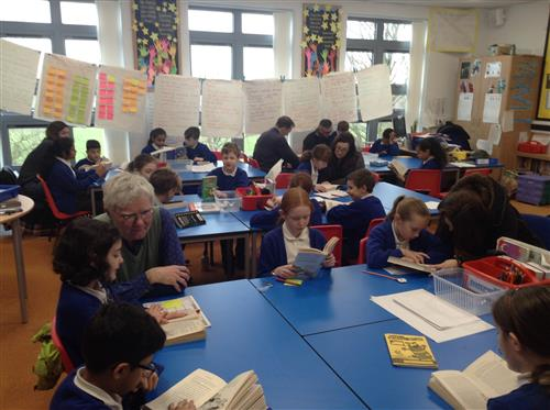 Parents and Carers of 5RC pupils share a good book...